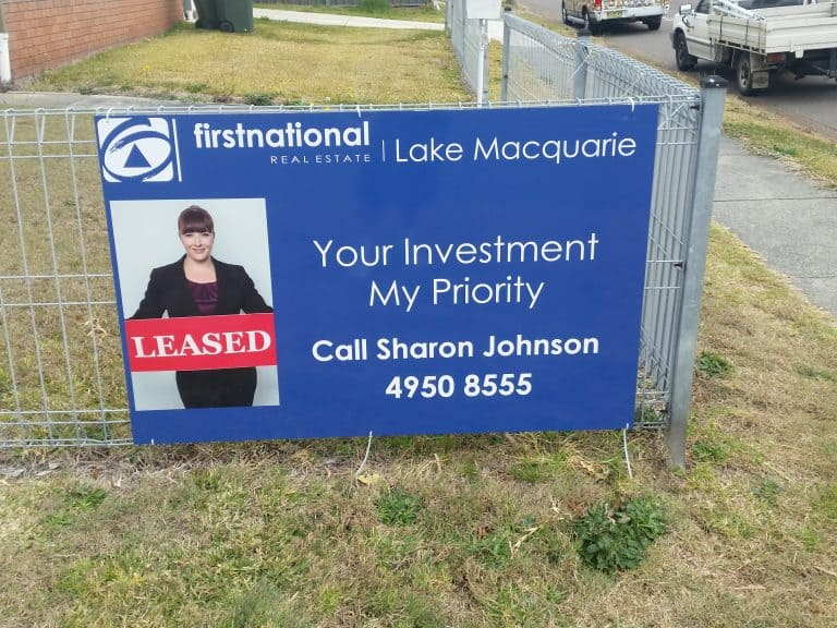 Business banner for First National Real Estate